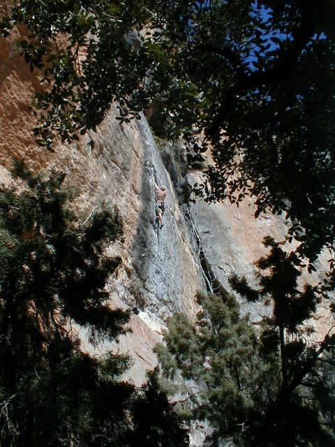 Tyler cranken on Isadora 5.12 on the Campi wall